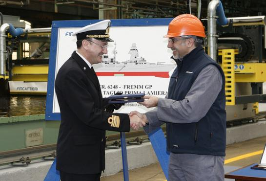image of Captain Sica (Director of UTNAV Genova) and Mr. Maggiolo (Director of Production of Fincantieri Shipyard in Riva Trigoso) during the first steel cutting ceremony